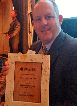 Brent Fields, CEO, with the 'Nonprofit of the Year' award.
