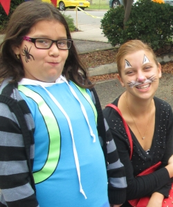 Little Sister gets spider face paint, while Big Sister opted for the cat look.
