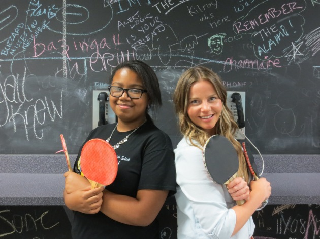 Little Sister Navaeh and Big Sister Courtney at Rackspace, just before starting a game of ping pong.